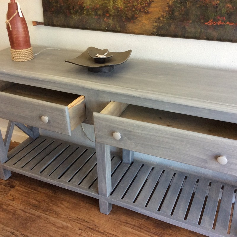 We get alot of buffet tables but this one is one-of-a-kind!  Painted and distressed in the oh-so- popular gray it has farmhouse written all over it. It features 2 super spacious drawers with dovetail jointing and the bottom provides even more storage/display space. Come take a look!