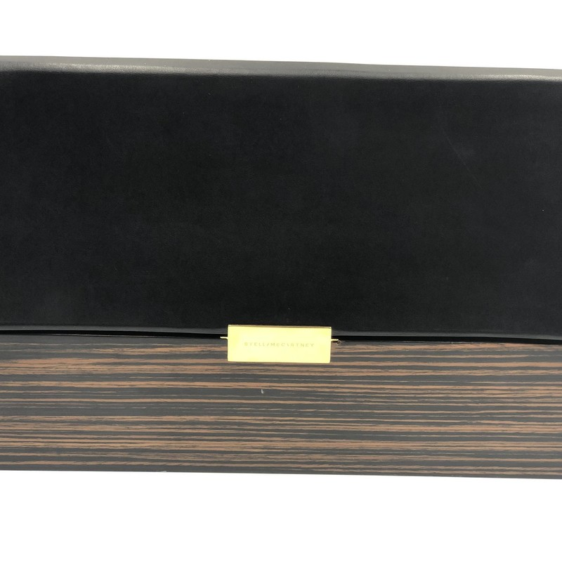 Stella McCartney Beckett Wood Clutch, Blk.Brn, Size: M<br /> <br /> Condition: GOOD. Minor scuffs and scratches on wood<br /> <br /> 8.5&quot; H x 14&quot; W x 2.5&quot; D