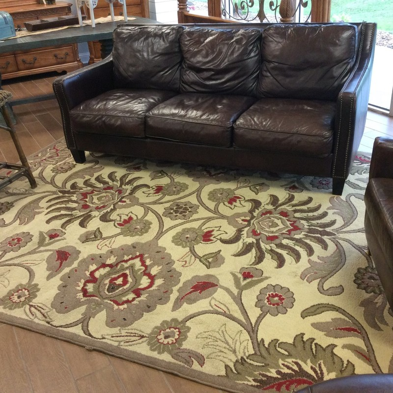 This handsome rug is priced to move at only $165. It does show some signs of wear, but mainly it's just around the edges. The tan/taupe color is neutral enough to go with most anything!