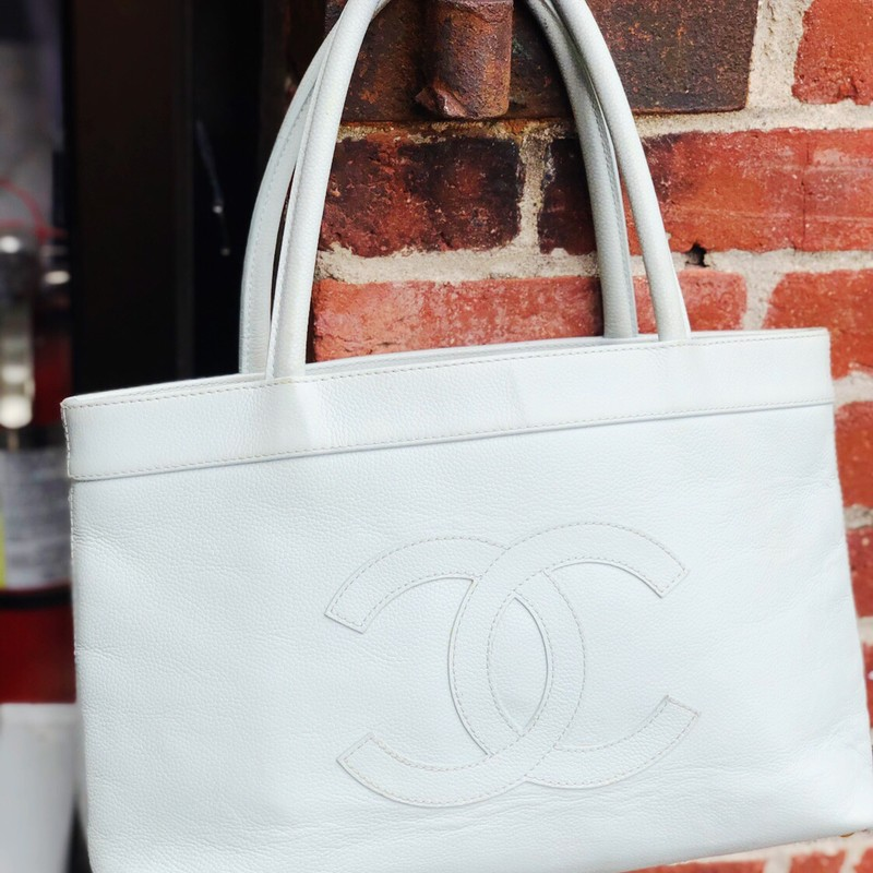 Chanel Timeless Tote, Blue, Size: .Chanel<br /> light blue caviar leather with cream lining. lining has wear and could use a professional cleaning to remove some makeup and ink stains. The handle have significant stains on underside and a noticeable mark on top handle also. a great buy at this price!