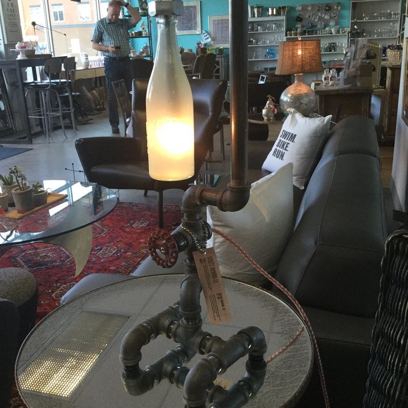 "This Beer Bottle Fuse Lamp is sure to generate lots of fun conversations! Made of plumbing pipes and a vintage Schlitz beer bottle, it tops out at 26"" tall."