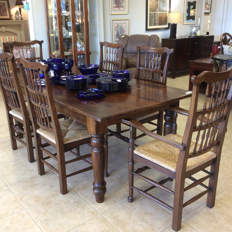 "Wow, this is a gorgeous dining room set. It features solid wood construction and the chairs have thatched rush seats. The table surface is ""distressed"" and both the table and the chairs have an espresso finish."