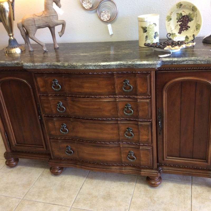 This is a gorgeous piece of furniture! Made by BERNHARDT, this piece truly makes a statement. It features solid wood construction, medium cherry finish, pretty carved accents, pewter hardware and an unusual unpolised granite top. Stop by and check it out!