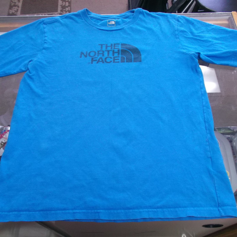 The North Face YOUTH Short Sleeve Shirt Size Large Blue Cotton Blend #9036<br /> Rating:   (see below) 3 - Good Condition <br /> Team: n/a<br /> Player: n/a<br /> Brand: The North Face<br /> Size: Large - YOUTH(Measured Flat: Across Chest 18&quot;; Length 24&quot;) Top of shoulder to the hem<br /> Color: Blue<br /> Style: Short Sleeve Shirt<br /> Material: Cotton Blend<br /> Condition: - Good Condition - wrinkled; Material is faded and discolored; Significant pilling and fuzz; Some light stains; Definite signs of use; No rips or holes(See Photos for condition and description)<br /> Shipping: $3.37<br /> Item #: 9036