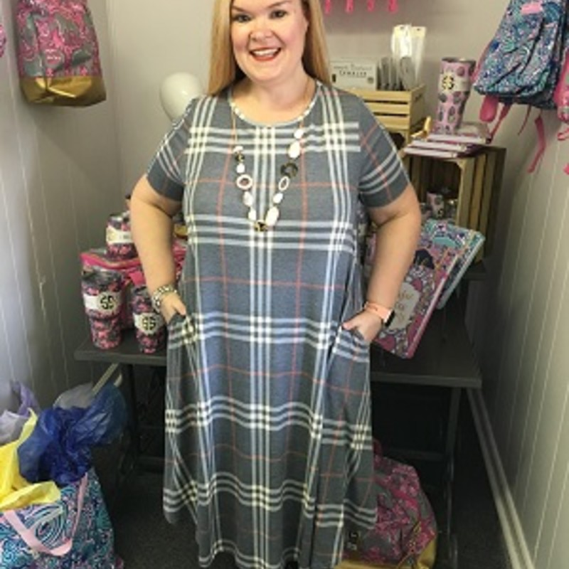 Our Plaid Print Midi Dress is now available and looks gorgeous on. You can wear this to any occasion. The material has a lot of stretch made of 95% Polyester 5% Spandex with a length of 41 inches.