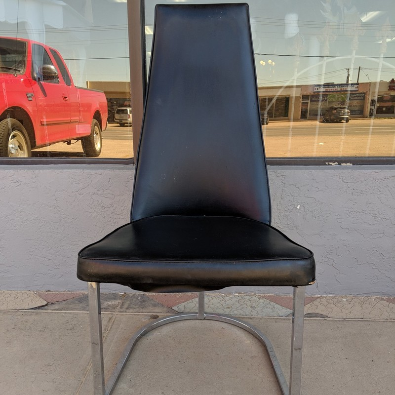 "High Back Chair Chrome<br /> Small flaw on seat<br /> Black<br /> 38.5"" tall"