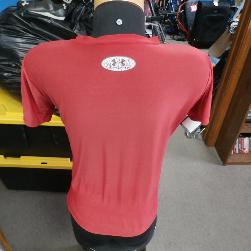 "Under Armour red HeatGear athletic shirt size YOUTH XL polyester blend #31936<br /> Rating: (see below) 4- Fair Condition<br /> Team: n/a<br /> Player: n/a<br /> Brand: Under Armour<br /> Size: Girl's YOUTH XLarge (Measured Flat: Across chest 17""; Length 23"")<br /> Measured Flat: underarm to underarm; top of shoulder to bottom hem<br /> Color: red<br /> Style: short sleeve; screen printed<br /> Material: 82% polyester 18% spandex<br /> Condition: 4- Fair: wear, discoloration and stretching from use; small snags and runs throughout (see photos)<br /> Item #: 31936<br /> Shipping: FREE"