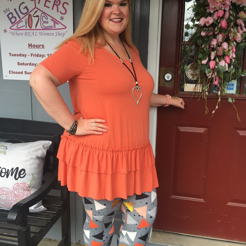 Tonya looks gorgeous in our new Ash Copper Zenana Ruffle Bottom Top. You can wear these all year round and still  look cute and stylish. The material is comfortable made of 55% Polyester 40% Rayon 5% Spandex with a length of 32.5in.