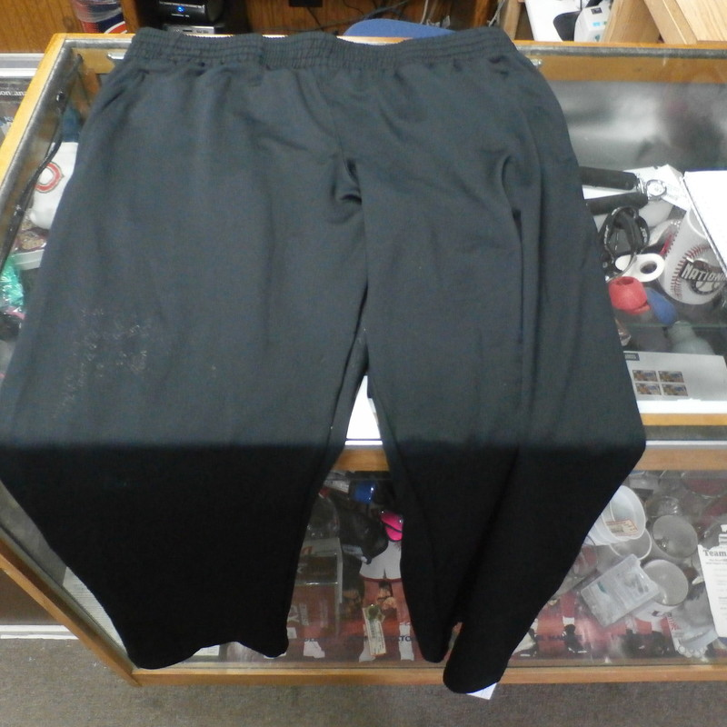 "Under Armour black athletic pants size XL polyester blend #31083<br /> Rating: (see below) 3- Good Condition<br /> Team: n/a<br /> Player: n/a<br /> Brand: Under Armour<br /> Size: Men's XLarge- (Measured Flat: Across waist 19""; Length 42"" inseam 32"")<br /> Color: black<br /> Style: elastic waistband with drawstring; ankle zippers<br /> Material: 95% polyester 5% spandex<br /> Condition: 3- Good Condition: original tags still attached; sticky stains on front of right leg and on the butt from a manufacturer's defect (see photos)<br /> Item #: 31083<br /> Shipping: FREE"