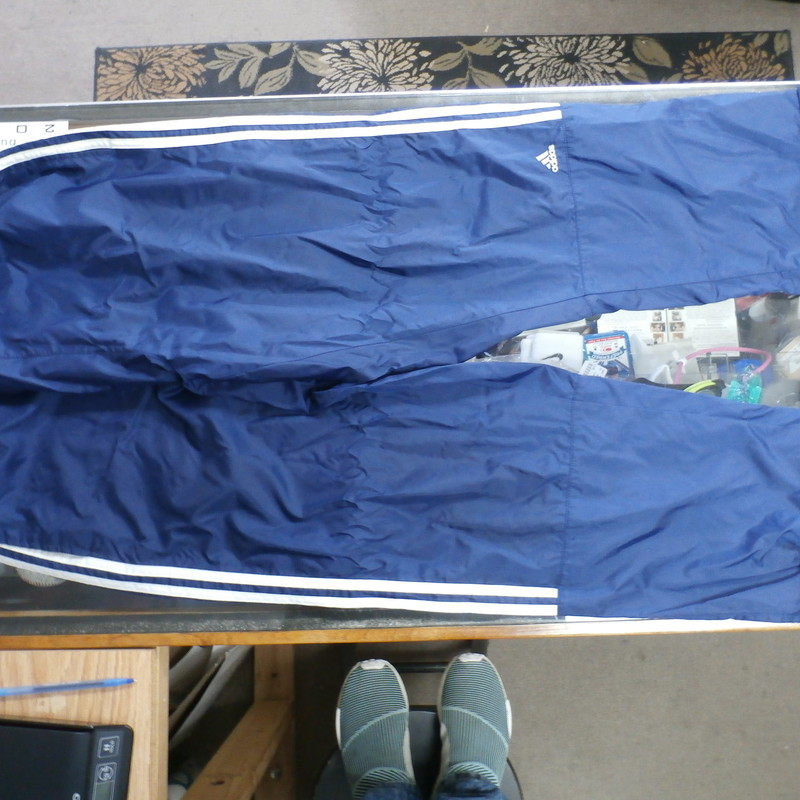 "adidas Men's Track Pants Size Large blue nylon #31930<br /> Rating: (see below) 3- Good Condition<br /> Team:N/A<br /> Player: N/A<br /> Brand: adidas<br /> Size: Men's   Large - (Measured Flat: Waist 15""; Length 41""; Inseam 30"")<br /> Measured flat: hip to hip; hip to hem; and groin to hem<br /> Color: blue<br /> Style: track pants; elastic waist with draw string<br /> Material: 100% Nylon<br /> Condition: 3- Good Condition: wrinkled; flaws are minimal ;<br /> Item #: 31930<br /> Shipping:FREE"