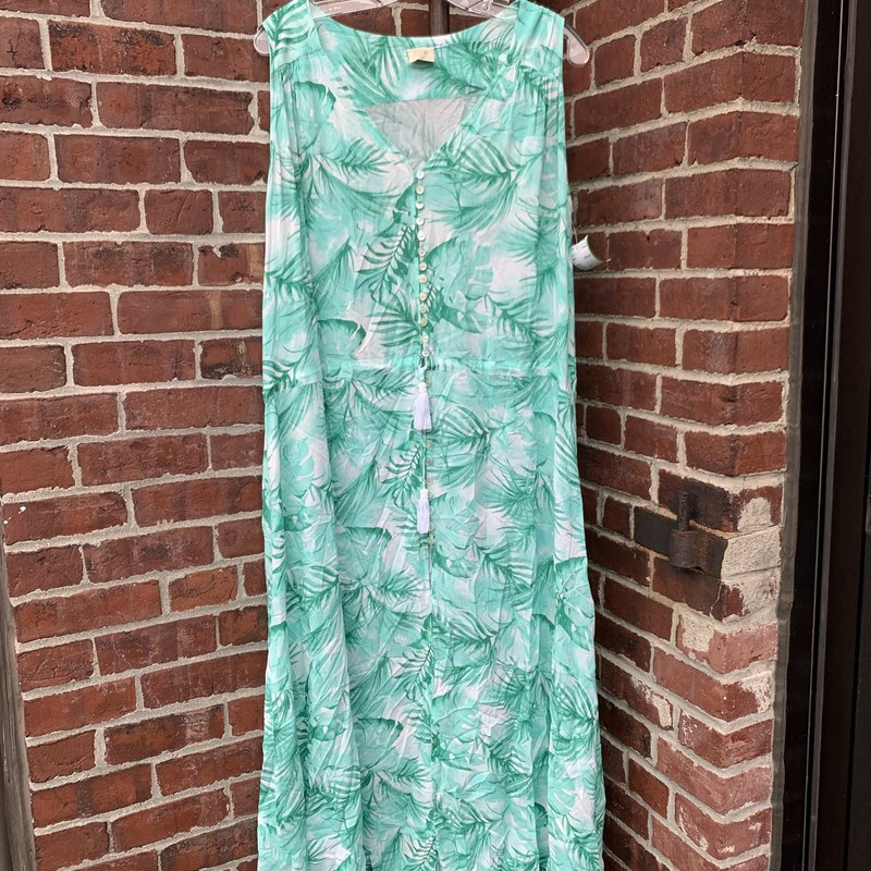 Malai Breach Dress in Summery Green Floral<br /> <br /> In Size S/M this is a lovly piece to wear to the beach!