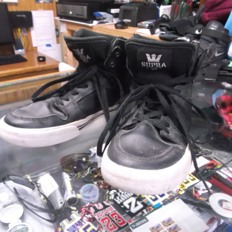"Supra Footwear YOUTH high top shoes black size 3 #9129<br /> Rating:   (see below) 4 - Fair Condition<br /> Team: n/a<br /> Player: n/a<br /> Brand: Supra Footwear Co<br /> Size: 3- YOUTH (Measured : width at widest point on bottom 3 3/8""; length 9.25"") <br /> measurements are from front to back and across bottom at widest point; - please check measurements. <br /> Color: black<br /> Style: athletic shoes; lace up; high tops <br /> Material: synthetic <br /> Condition: - Fair Condition - some dirtiness; some pilling and fuzz inside on the soles; bottoms are also dirty; will clean up good; laces are tied tight and have been dragging a little; scuffs (See Photos for condition and description)<br /> Shipping: $6.65 -will ship in a paddle envelope<br /> Item #: 9129"