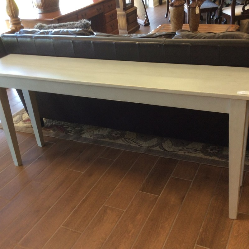 This CUSTOM beauty is solid wood and has a painted matte dove gray finish. It is both sleek and simple. We actually have FOUR of these tables available for sale. The remaining ones are all different shades of matte gray.