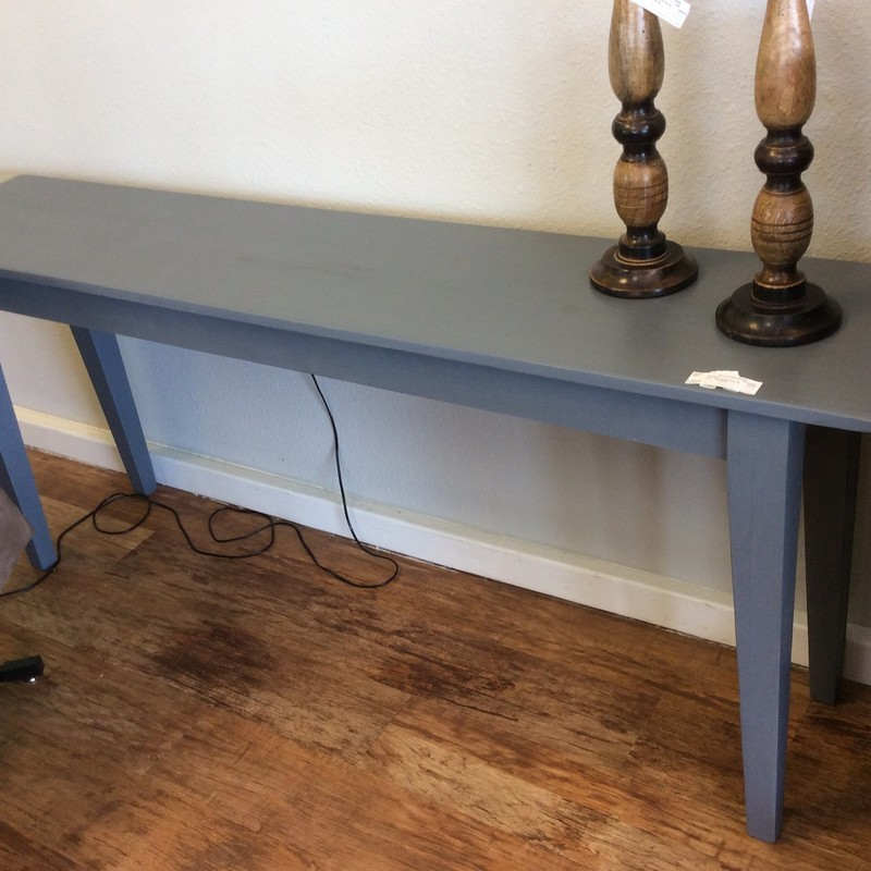 This CUSTOM beauty is solid wood and has a painted matte medium gray finish. It is both sleek and simple. We actually have FOUR of these tables available for sale. The remaining ones are all different shades of matte gray.