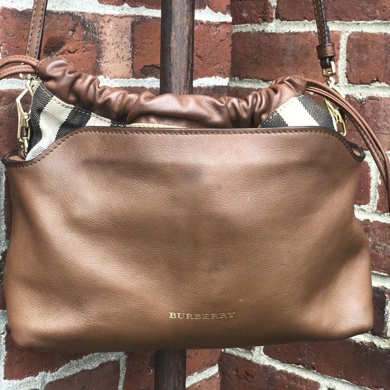 "Burberry Little Crush Cro, Brown, Size: .Burberry<br /> Brown leather Burberry Little Crush crossbody bag with gold-tone hardware, single detachable shoulder strap, tan and multicolor House Check canvas trim, black canvas lining, three pockets at interior wall; one with zip closure and magnetic snap closure at top. Measures:<br /> Height: 10""<br /> Width: 11""<br /> Depth: 3.5""<br /> Very good condition. Minor marks on exterior."