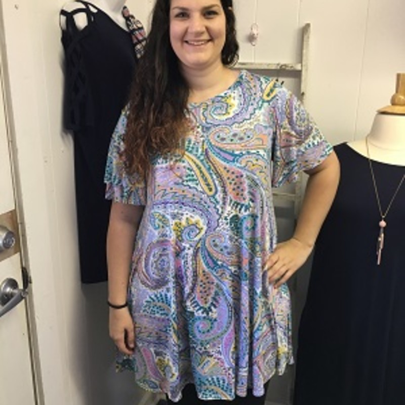 Our Ruffle Sleeve Paisley Pocket Dress is now available and looks fantastic on. You can wear this to work or a night on the town.  The material has a lot of stretch made of 92% Polyester and 8% Spandex with a length of 37 inches.