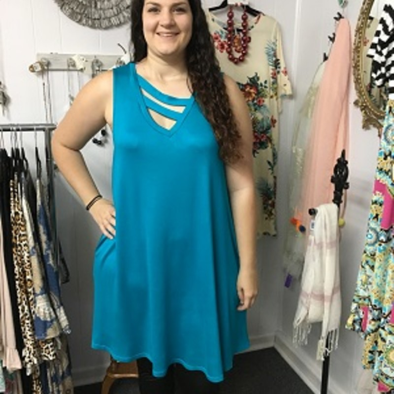 Our Strap Detail Solid Knit Teal Pocket Dress is now available and looks amazing on. You can wear this to work or a night on the town. The material has a lot of stretch made of 65% Rayon, 32% Polyester,  and 3% Spandex with a length of 37.5 inches.