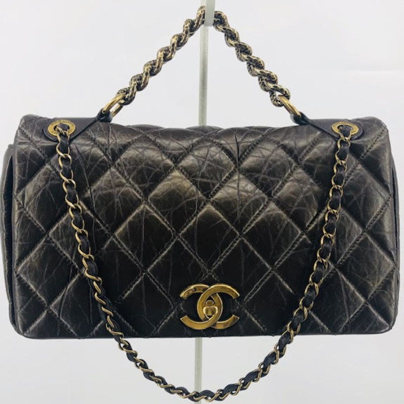 Chanel bronze quilted bag, single flap<br /> interesting, textured double strap design<br /> Amazing condition, LIKE NEW