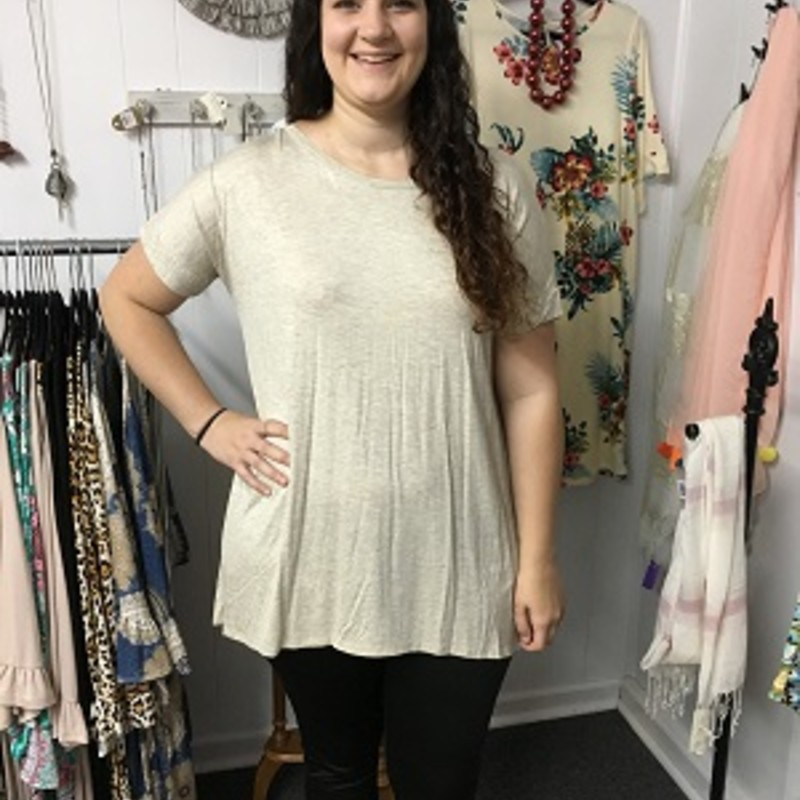 Our Loose Fit Criss Cross Back Tunic in Oatmeal is now available and looks amazing on. You can wear this with leggings or capris. The material has a lot of stretch made of 94% Polyester and 6% Spandex with a length of 31 inches in front and 34.5 inches in the back.