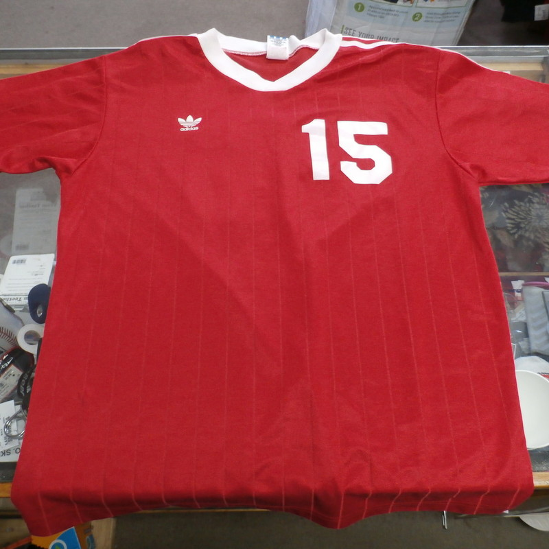 "adidas Men's shirt size Large red short sleeve polyester blend #32177<br /> Rating:   (see below) 3- Good Condition<br /> Team:  N/A<br /> Player: Team<br /> Brand: adidas<br /> Size: Men's    Large (Measured Flat: across chest 20"", length 27"")<br /> Measured flat: armpit to armpit; top of shoulder to the bottom hem<br /> Color:  red<br /> Style: screen pressed; short sleeve;<br /> Material:  75% polyester 25% cotton<br /> Condition: - 3- Good Condition - wrinkled; minor pilling and fuzz; minor stretching; minor discoloration;<br /> Item #: 32177<br /> Shipping: FREE"