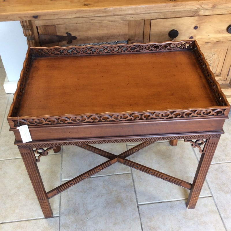 This little table is simply charming! It features solid wood construction and has a cherry finish. There are beautiful, intricate carved details everywhere on this piece. Stop by and check it out!