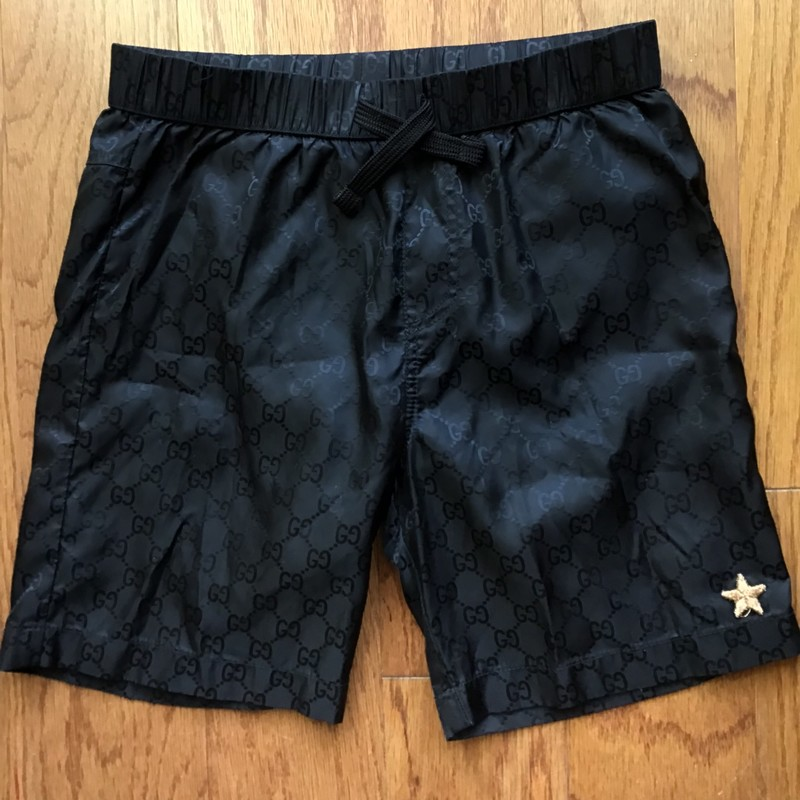 Gucci Swim Trunk AS IS, Black, Size: 5<br /> <br /> <br /> AMAZING DEAL - COMPARE TO $300 RETAIL!!!!<br /> <br /> AS IS DUE TO LIGHT SNAGS ALL THROUGHOUT THE BACK BUTT AREA AS WELL AS ON THE FRONT LEFT SIDE. PLEASE SEE ALL PICS. STILL AN AMAZING DEAL COMPARED TO $300 RETAIL!<br /> <br /> REFLECTIVE GG LOGO PATTERN ALL THROUGHOUT. HE WILL BE THE MOST STYLISH CUTIE AT THE POOL!<br /> <br /> <br /> ALL ONLINE SALES ARE FINAL. NO RETURNS OR EXCHANGES.