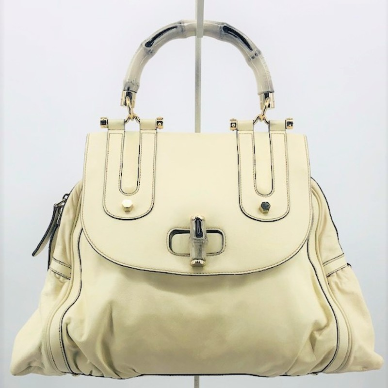 Gucci bone leather satchel with bamboo top handle and original long bone leather long strap, good condition
