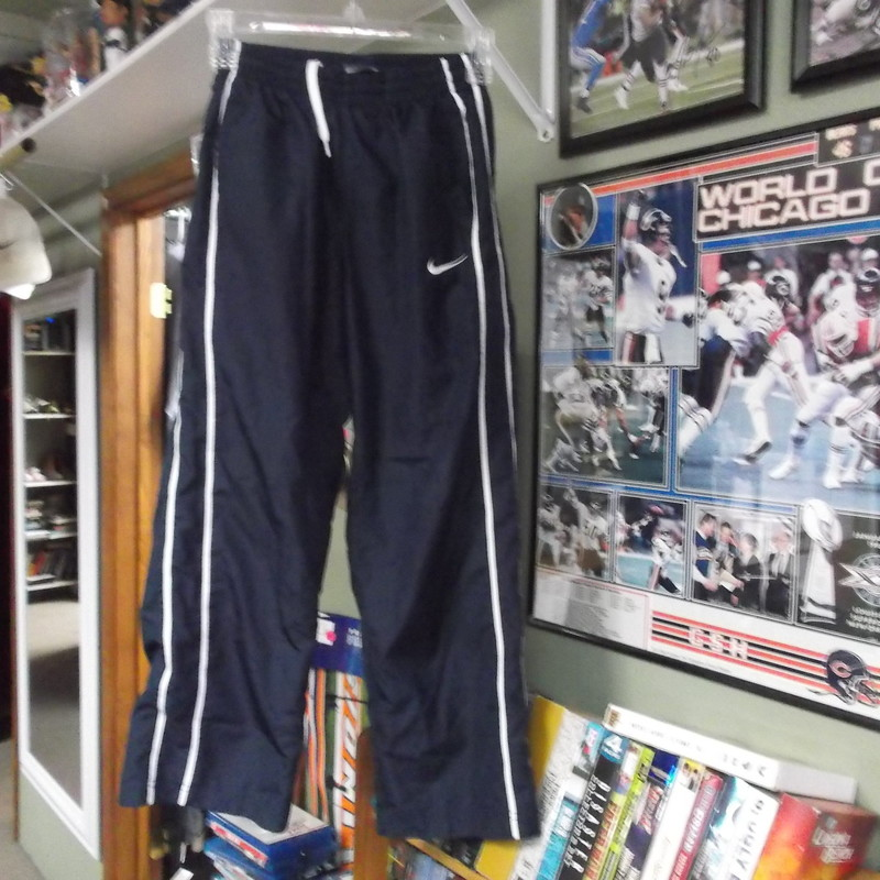 Nike YOUTH air pants size Medium Blue polyester shell # 9136<br /> Rating:   (see below) 3 - Good Condition <br /> Team: n/a<br /> Player: n/a<br /> Brand: Nike<br /> Size: Medium- YOUTH (Measured : waist 11&quot;; length 33&quot; inseam 24&quot;) <br /> measurements are across waist laying flat and from waist to bottom of leg opening; - please check measurements.  <br /> Color: blue <br /> Style: air pants with lining; pockets; drawstring and elastic waist<br /> Material: 100 polyester shell; 65 cotton 35 polyester lining <br /> Condition: - Good Condition -  minor fuzz and pilling; wrinkled; they look great; hole L knee that only breaks the shell; (See Photos for condition and description)<br /> Shipping: $4.06<br /> Item #: 9136
