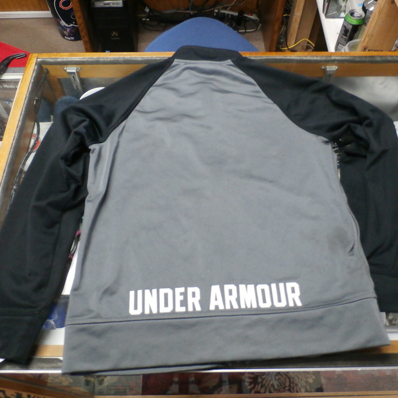 "Under Armour gray YOUTH full-zip jacket size YMD 100% polyester #32176<br /> Rating: (see below) 3- Good Condition<br /> Team: n/a<br /> Player: n/a<br /> Brand: Under Armour<br /> Size: Boy's YOUTH Medium- (Measured Flat: Across chest 18""; Length 21"")<br /> Measured Flat: underarm to underarm; top of shoulder to bottom hem<br /> Color: gray<br /> Style: long sleeve; screen printed<br /> Material: 100% polyester<br /> Condition: 3- Good Condition: minor wear and some pilling; light stains on lower front (see photos)<br /> Item #: 32176<br /> Shipping: FREE"