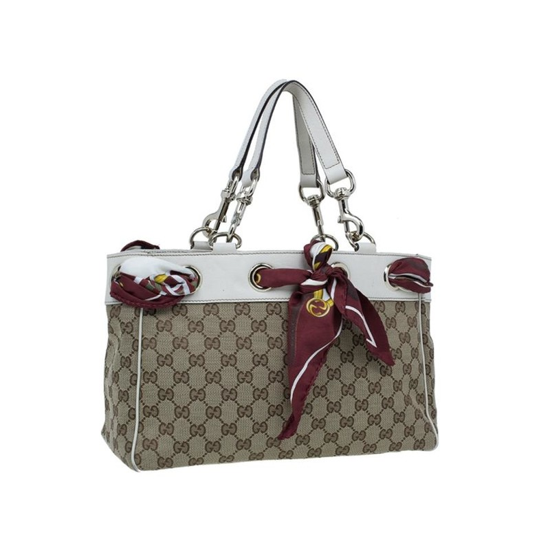 Gucci Beige GG Canvas Positano Tote Bag, Tan/mono, Size: Med<br /> <br /> on't miss out your opportunity to own this chic Gucci Beige GG Canvas Positano Bag. This popular style features durable GG fabric with a red Gucci silk scarf interlaced at the top. Its roomy interior is perfect for holding all your daily essentials in style. We can always count on Gucci for styles that we will love now and later.