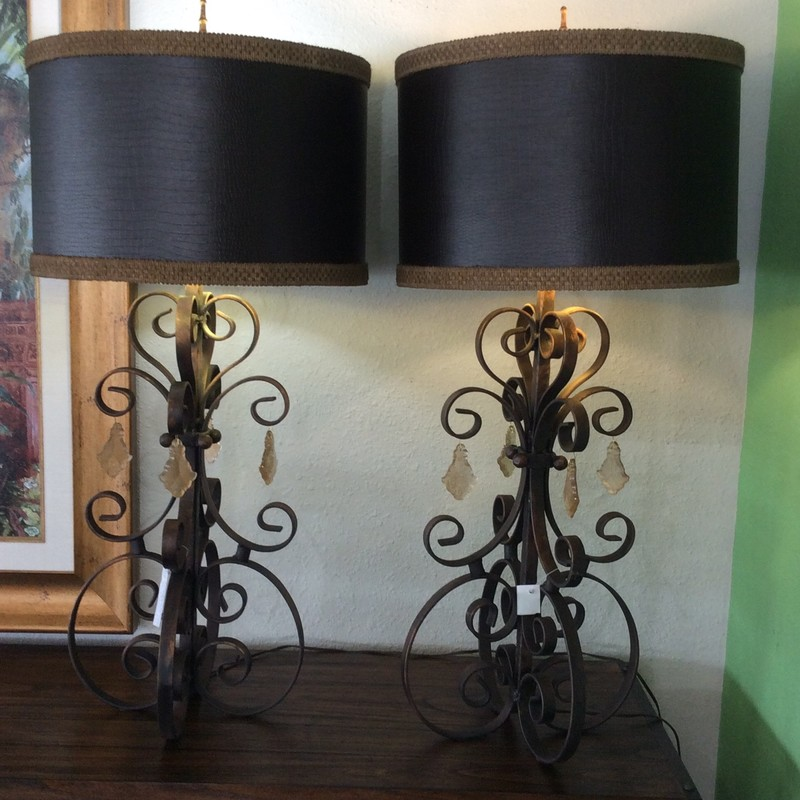 This handsome pair of lamps is in excellent condition. The bases are formed from scrolled iron and have an antiqued bronze finish. The shades have an espresso colored, faux crocodile pattern with taupe trim. The hanging crystals add an additional touch of class, too!