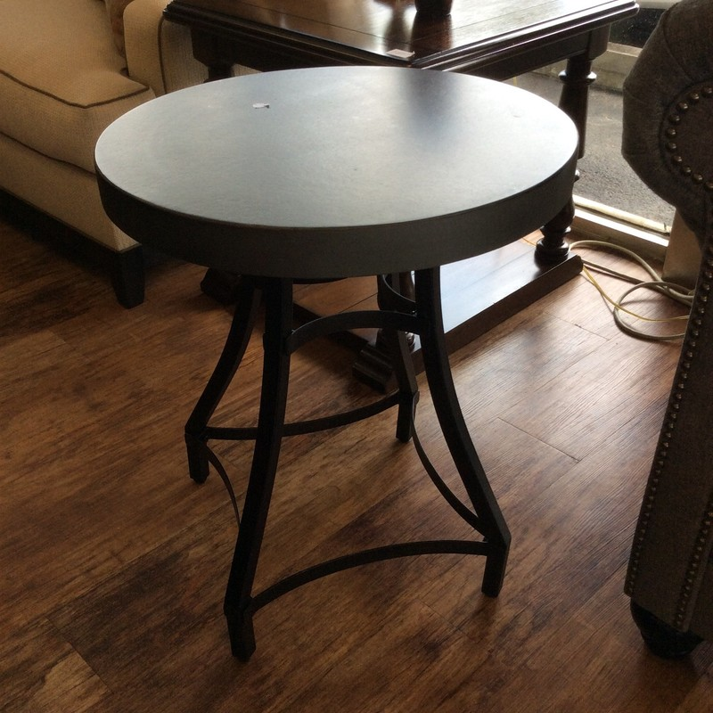 These sturdy tables are actually quite pretty. They feature iron bases with a matte black finish. The faux-cement composite tops are dark gray and in vey good condition.