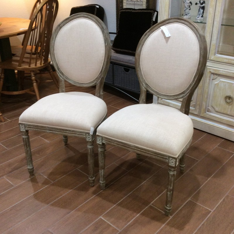 This is a beautiful pair of chairs! The chair frame has been painted and distressed and the seat cushions upholstered in a cream colored linen.