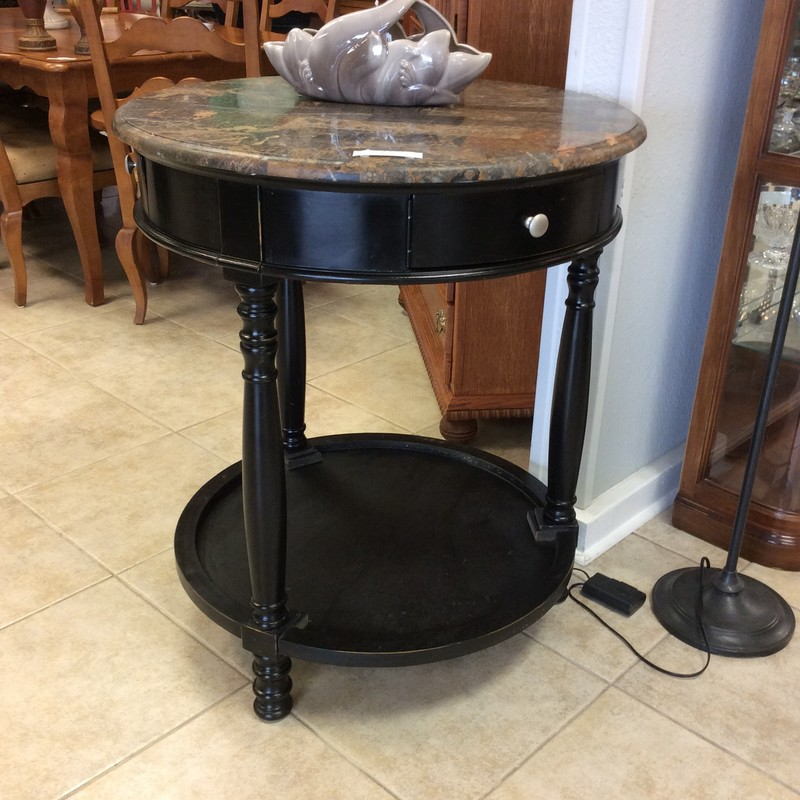 This is a charming 2-tiered table with tons of personality! Painted black with turned legs the top is granite. It features 3  cubbies with with doors that swing open. Come by and take a look!
