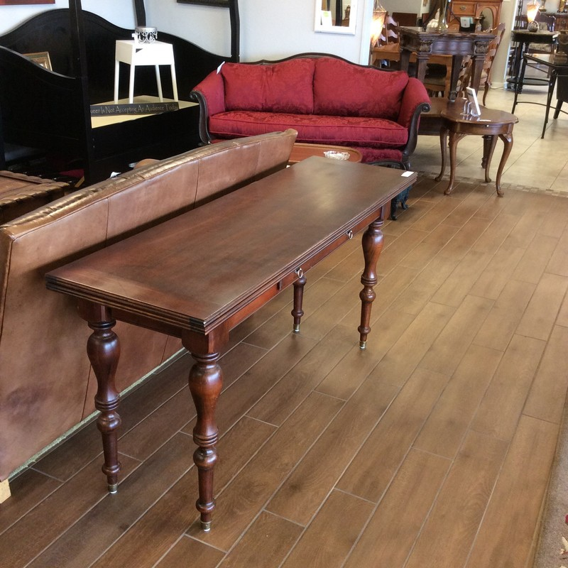 "This is an extremely practical expandable ETHAN ALLEN table. It's 64 inches wide and when it's in it's smallest state, it's only 19 inches deep. It expands from 19"" deep to 38"" deep when the top is flipped open and the legs are extended. Stop by and see this piece for yourself!"