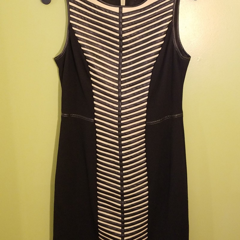 Gorgeous knit dress with faux leather strips down tan panel front.