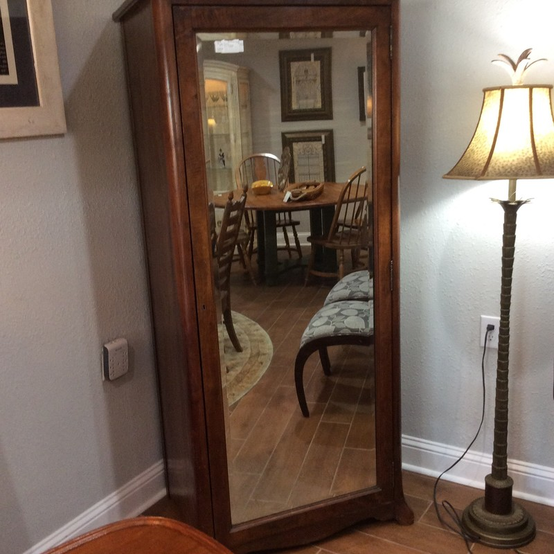 This is a gorgeous old piece! It's a vintage mirrored armoire, elegant and refined. It features 5 shelves which are extra deep - this would make it a perfect way to store blankets, comforters or linens. Or how about in a bathroom? The front features a full-length mirror. Comes with a key too.