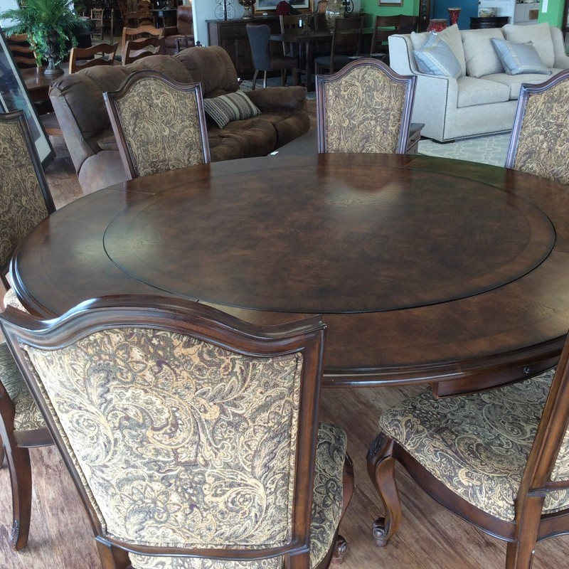 WOW, this set is a real stunner! The table starts off as a 58 inch round that can quickly be expanded to 80 inches around, with the addition of the 4 OUTER leaves. The 8 wood chairs are upholstered in a pretty paisley brocade on the backs, as well as the fronts. Priced at only $1295, so hurry in!