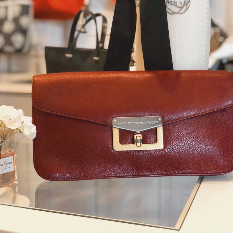 "Marc By Marc Jacobs Clutc, Burgundy, Size: Large<br /> Like New oversized Marc By Marc Jacobs Clutch<br /> Measures 3""w by 7.5"" tall. Like new!"