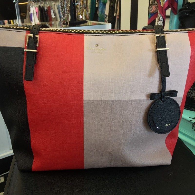 LIKE NEW Kate Spade color block tote. Red, pink, taupe, and black blocks with black trim and lining, and gold hardware. A few signs of wear on the exterior, couple scuffs (will show in photos). WON'T LAST!