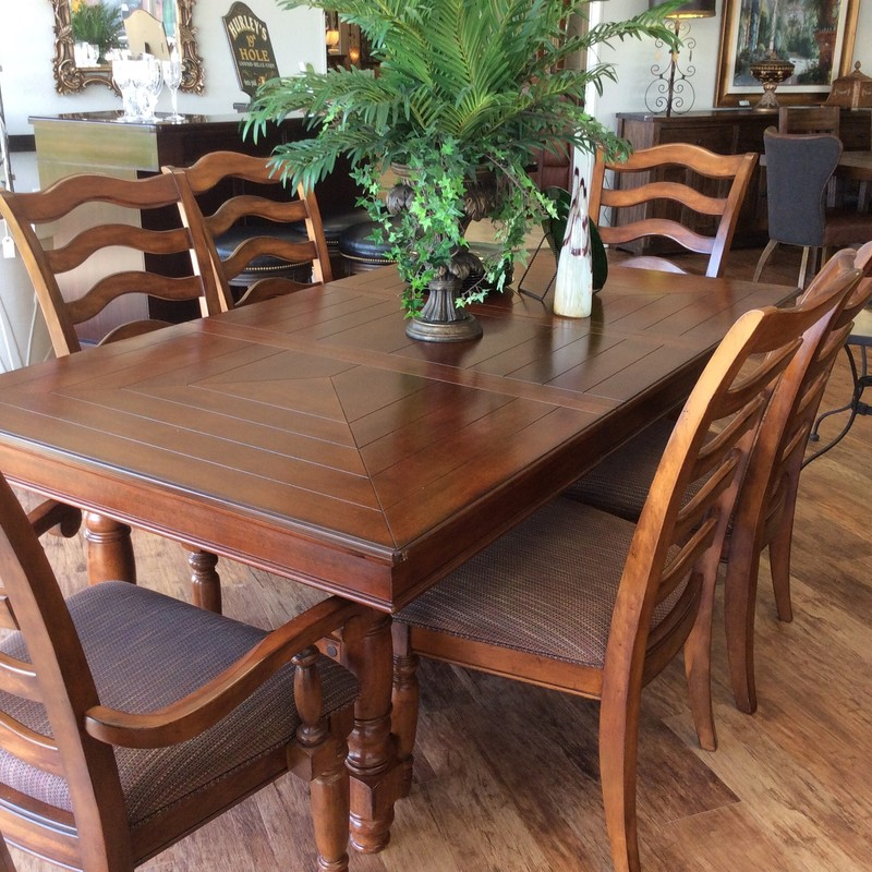 This is a handsome, solid wood dining room set. The table measures 57 inches long, and 44 inches wide. There are two 20 inch leaves, as well, which make the table 97 inches long when inserted. The 6 chairs, 2 of which are arm chairs, are very comfortable, too. This set is priced well at only $995 for all of it!