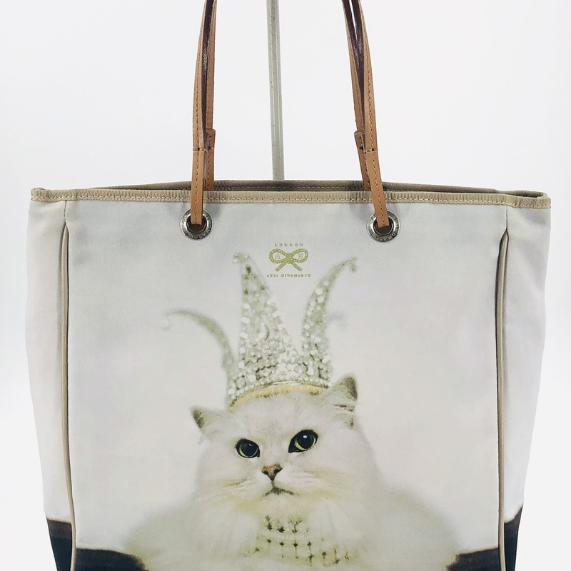 "Anya Hindmarch kitty cat tote, printed fabric with leather trim<br /> Measurements:<br /> 11.5"" h<br /> 11"" w<br /> 3"" d<br /> 6"" strap drop"