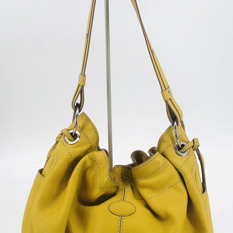 "Tod's mustard yellow leather shoulder bag<br /> <br /> Measurements:<br /> 10"" h<br /> 14"" w<br /> 8.5"" d<br /> 13"" strap drop"