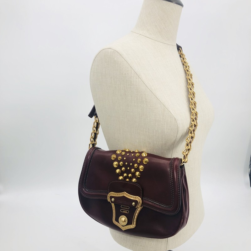 Miu Miu burgundy leather and goldtone stud shoulder bag<br /> metal and leather strap, interesting stud detail