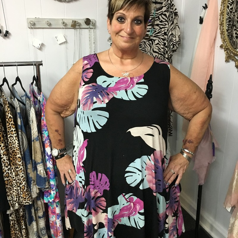 Our Leaf Print Sleeveless Pocket Dress is now available and looks gorgeous on. You can wear this for  any occasion. You can wear this to work or a night on the town.  The material has a lot of stretch made of 96% Polyester 4% Spandex with a length of 36 in.