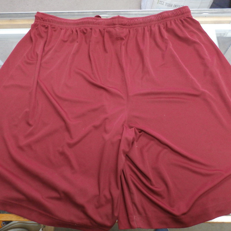 "Under Armour Men's shorts size 3XL Burgundy #32714<br /> Rating:   (see below) 3- Good Condition<br /> Team: N/A<br /> Player: N/A<br /> Brand: Under Armour<br /> Size: Men's   3XL (Measured Flat: across waist 19"", length 22"" Inseam 9"" )<br /> Measured flat: hip to hip; hip to hem; and groin to hem<br /> Color: burgundy<br /> Style: Shorts; screen pressed; elastic waist;<br /> Material:  100% polyester<br /> Condition: - 3- Good Condition - wrinkled;  pilling and fuzz; minor stretching; one very small stain on the back leg;<br /> Item #: 32714<br /> Shipping: FREE"