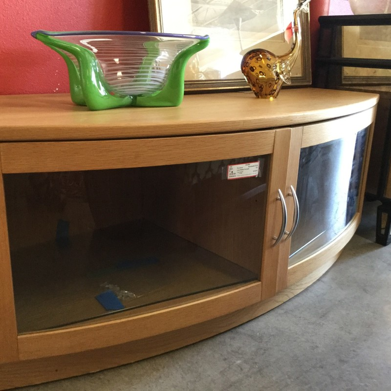 This light-wood, bowed glass piece has room for the largest TV on top and electronics down below. Size: 49.21.20""