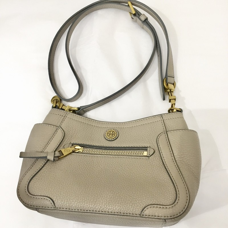 "Tory Burch taupe leather small crossbody<br /> <br /> Measurements:<br /> 6"" h<br /> 8.5"" w<br /> 4"" d<br /> 22"" strap drop"