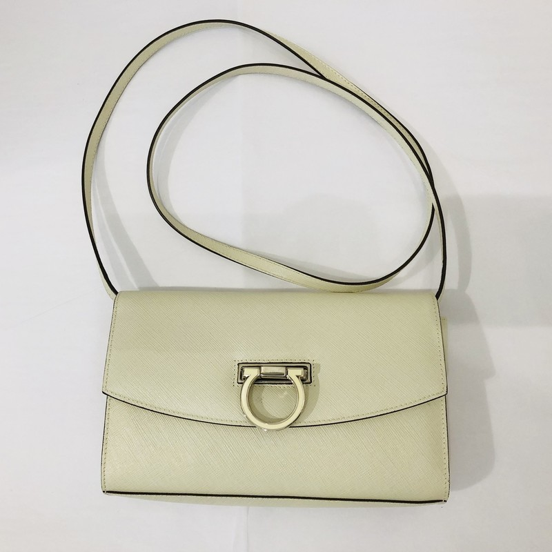 "Salvatore Ferragamo bone saffiano leather crossbody,<br /> cream enamel Ferragamo logo closure<br /> <br /> Measurements:<br /> 5"" h<br /> 8"" w<br /> 2"" d<br /> 21"" strap drop"