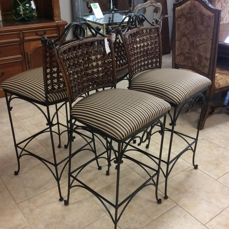 This is a beautiful set of barstools! A combination of metal, wood and fabric makes them versatile and unique. Casual in style but yet sophisticated they would complement many different looks. Framed in a curvy black metal the seats are upholstered in an attractive black, taupe and tan stripe. The seat backs are woven. They're kind of the total package!